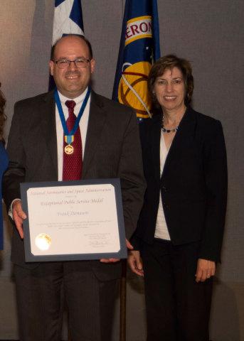 Orbital ATK's Frank DeMauro receives the NASA Exceptional Public Service Medal from Johnson Space Center Director Ellen Ochoa. (Photo: Business Wire)