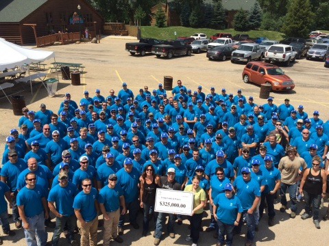 More than 200 ADM employees gather at Starved Rock State Park in Oglesby, Illinois, to clean up debris and present Living Lands & Waters with a $325,000 donation to promote clean waterways. Credit: Living Lands & Waters