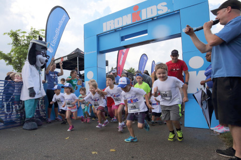 Local youth take off at the first UnitedHealthcare IRONKIDS Racine Fun Run today at North Beach Park. UnitedHealthcare mascot Dr. Health E. Hound kicked-off the fun run, joined by Ginger Dzick, UnitedHealthcare Community Plan of Wisconsin vice president. Source: Asher Imtiaz