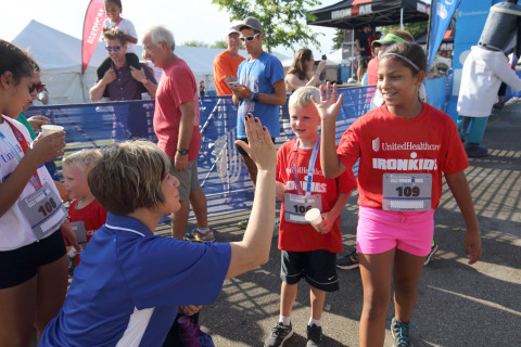 The first UnitedHealthcare IRONKIDS Racine Fun Run raced around North Beach Park today. IRONKIDS staff and Ginger Dzick, UnitedHealthcare Community Plan of Wisconsin vice president, handed out medals to nearly 100 local youth as they crossed the finish line. Source: Asher Imtiaz