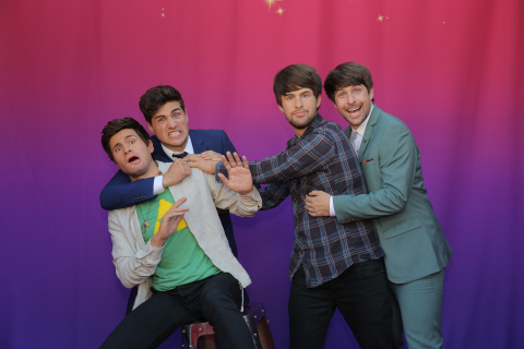 SMOSH's Anthony Padilla (left) and Ian Hecox (right) pose with their Madame Tussauds wax selves at the premiere of SMOSH: The Movie. Photo credit: Chelsea Lauren.