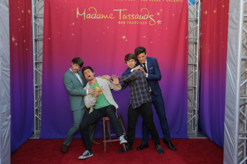 SMOSH's Ian Hecox (left) and Anthony Padilla (right) exercise their funny bones with their Madame Tussauds wax figures at the premiere of SMOSH: The Movie. Photo credit: Chelsea Lauren