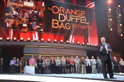 Glenn Williams, Primerica CEO, announces $50,000 award to the Orange Duffel Bag Initiative during Primerica's 2015 Convention in Atlanta. (Photo: Business Wire)