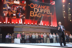 Glenn Williams, Primerica CEO, announces $50,000 award to the Orange Duffel Bag Initiative during Primerica's 2015 Convention in Atlanta. (Photo: Business Wire)