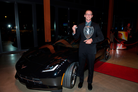 2015 Ryder Top Technician Stephen Radford holding his trophy and keys to a brand new Chevrolet Corvette Stingray. (Photo: Business Wire)