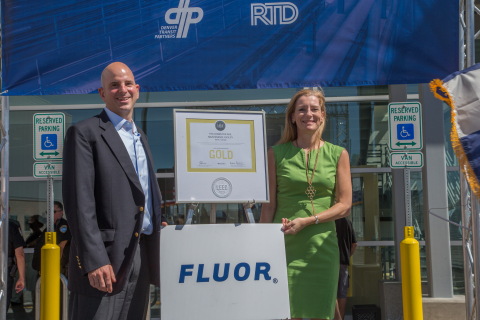 (L-R) Aaron Epstein, executive project director of the Fluor-led Denver Eagle P3 Project, and Lisa Bottle, Fluor's vice president of corporate communications, celebrate LEED Gold certification for the Regional Transportation District's commuter rail maintenance facility on Saturday, July 25, in Denver. (Photo: Business Wire)