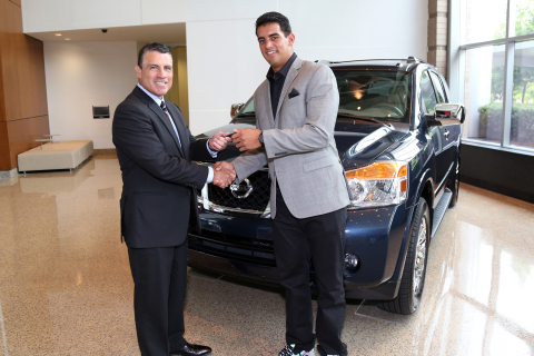 Tennessee Titans QB Marcus Mariota is presented the keys to a 2015 Nissan Armada by Fred Diaz, SVP, Nissan Sales and Marketing and Operations, USA, Tuesday, July 28, 2015, in Nashville, Tennessee, at Nissan North America headquarters. As part of the Heisman House campaign, Mariota joins 13 other former Heisman winners, in a series of broadcast and social media vignettes set to air throughout the upcoming college football season. (Photo: Business Wire)