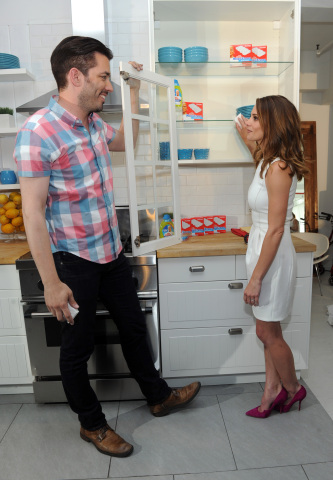 Home renovation expert Jonathan Scott shows actress Ashley Greene how to achieve a #15MinReno in your kitchen with Mr. Clean Concentrated Cleaner and Magic Eraser, Tuesday, July 28, 2015, in New York. (Photo by Diane Bondareff/Invision for Mr. Clean/AP Images)