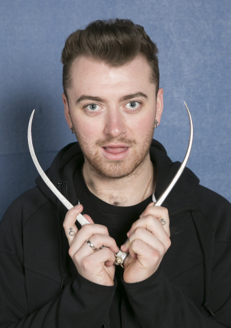 Sam Smith takes some of his own measurements at his Madame Tussauds sitting. (Photo: Business Wire)