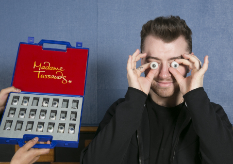 Sam Smith makes eyes at the camera during his Madame Tussauds sitting.(Photo: Business Wire)