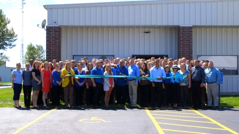 REG employees and leadership celebrated with a ribbon cutting at the company's opening of its second Ames building at 215 Alexander Avenue on July 28. (Photo: Business Wire)