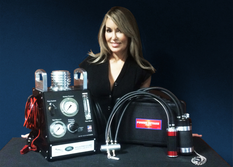 Executive Vice President, Alex Parker, with Redline's Award Winning Equipment. (Photo: Business Wire)