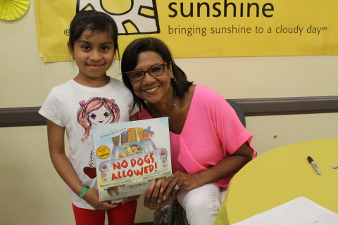 """""""A younger sibling suffered from asthma, so I know the impact this condition makes on the individual and also on the entire family,"""" said Sonia Manzano, children's book author and Sesame Street alumna. """"I'm happy to help Project Sunshine relieve some of the stress families endure. """"Manzano read her book """"No Dogs Allowed"""" to children enjoying a summer beach party at EHACE (East Harlem Asthma Center of Excellence) (Photo: Project Sunshine)."""