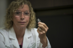 """Dr. Mary Beth Tomaselli shows the BioZorb 3D bioabsorbable marker, a small coil inserted into the breast by the surgeon when a breast cancer tumor is removed. The device holds six tiny clips arranged in a three-dimensional array. This 3D array remains over time, while the coil holding the clips dissolves. """"This is a great innovation,"""" said Dr. Tomaselli, which has been """"very well received by radiation oncologists, and it's a benefit to the patients in getting more accurate radiation therapy and a more satisfying cosmetic result."""" (Photo: Business Wire)"""