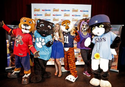 "Friskies® ""official spokescat"" Grumpy Cat poses with her mascot friends at the premiere of her new video ""Happiness Finds Grumpy Cat"" featured on YouTube.com/BuzzFeed at the Tampa Theatre on Tuesday, Aug. 4, 2015 in Tampa, Fla.  Friskies and PetSmart teamed up for this one-of-a-kind event to help promote the Friskies Variety Pack with Grumpy Cat packaging, and educate consumers that PetSmart is both cat-friendly and a cat resource, in Tampa, Fla. (Brian Blanco / AP Images for Friskies)"