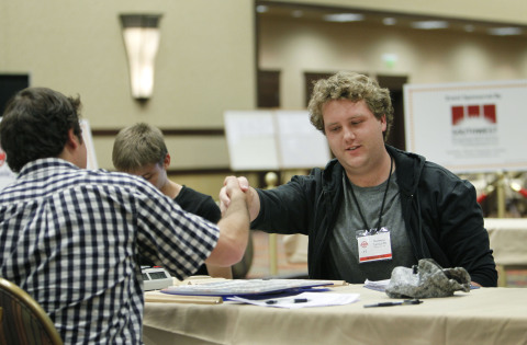 Matthew Tunnicliffe, of Ottawa, ON, shakes hands with Jesse Day of Berkeley, Calif. after defeating him in the fifth and final round to win the 2015 North American SCRABBLE Championship on Wednesday, Aug. 5, 2015 in Reno, NV. (Photo: Business Wire)