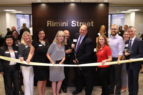 Rimini Street Las Vegas Ribbon Cutting Event with Las Vegas Metro Chamber of Commerce president & CEO Kristin McMillan (fourth from left), and Rimini Street CEO Seth Ravin (next to McMillan) Photo courtesy of Matt Paddock, MP Productions.