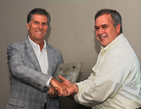 Industrial chemical supplier AfTon Chemical president Rob Sharma receives Receives award from Todd VanderVen (right), President, BSI Group Americas Photo business wire.com