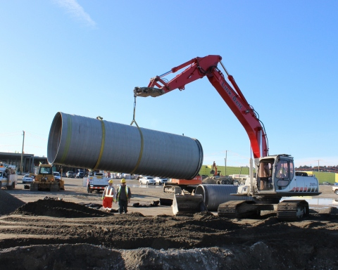 Delivered from the recently opened ADS distribution yard in Abbotsford, a 6-meter (20-foot) long section of large diameter SaniTite HP pipe is moved into place for a nearby mega-mall project. (Photo: Business Wire)