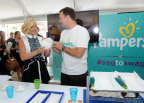 "Actress and mom Jane Krakowski learns about the new and improved Pampers Cruisers diapers from Scott Reese, of Pampers, at the launch of the Pampers Cruisers #SagToSwag Tour in New York, Wednesday, Aug. 12, 2015. Pampers is going on a national tour to transform the nation's babies from ""sag to swag"" by helping to prevent diaper sag. (Photo by Diane Bondareff/Invision for Pampers/AP Images)"