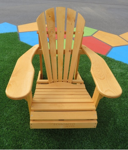 This Muskoka chair made by The Bear Chair Company, constructed with natural wood and stamped with TO ...