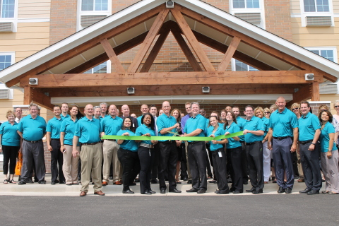 Local officials, WoodSpring Suites associates, and hotel guests gather for the celebratory ribbon-cutting marking the grand opening of WoodSpring Suite's first namesake hotel. (Photo: Business Wire)
