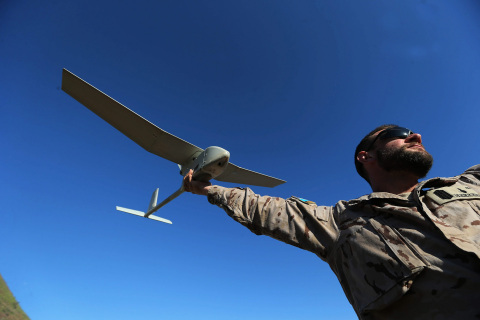 A Spanish Military Member Launches the RQ-11B Raven Unmanned Aircraft System (Photo by Jaime Garcia)