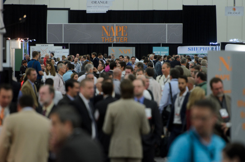 Attendees walk shoulder to shoulder, discussing opportunities in front of the NAPE Prospect Theater, where select E & P exhibitors have the opportunity to present their best deals. (Photo: Business Wire)