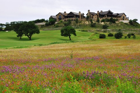 The Boot Ranch Clubhouse Village, a 55,000 sq. ft luxury clubhouse with member lodges, golf pro shop, numerous dining and social spaces, spa and outdoor spaces with long distance views. (Photo: Business Wire)