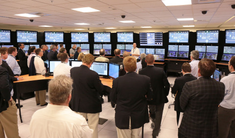 NuEx attendees tour world's first Small Modular Reactor (SMR) Control Room Simulator located at NuScale Power's Corvallis office. The simulator serves as a virtual nuclear power plant control room that allows NuScale to evaluate different approaches to the design and operation of a power plant using its technology. (Photo: Business Wire)