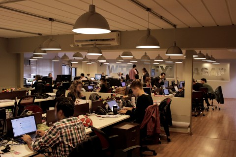 Employees at work in the Sao Paulo office of AD.Dialeto