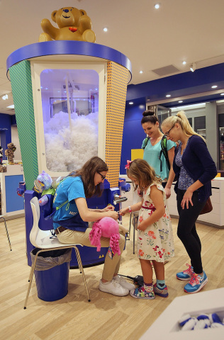 A guest creates a special furry friend at the newest Build-A-Bear Workshop at Mall of America in Bloomington, Minn., during a special grand opening ceremony today. Build-A-Bear Workshop celebrated the launch of a new look and feel for stores at today's ceremony complete with an updated storefront, fresh new logo, and seven-foot-tall stuffer – all part of the company's strategy to make its iconic experience even more memorable for guests. (Photo: Business Wire)