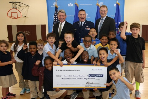 United Health Foundation awards the Boys & Girls Clubs of America with a $1.75 million grant at Peterson Air Force base in Colorado Springs Sept. 3, 2015. The grant will be used to create an interactive online platform and mobile application for military kids. Left to right: Kevin McCartney, BGCA Sr. Vice President for Government Relations, Col. Eric Dorminey, Vice Commander of 21st Space Wing, and Dr. John Williams, Sr, M.D., UnitedHealthcare Sr. Medical Director of Military & Veterans (Photo: Kim Cook/ap for the Boys & Girls Clubs of America).