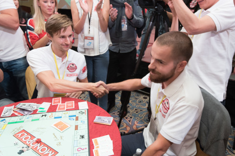 """Nicolò Falcone of Venice, Italy shakes hands with former MONOPOLY World Champion Bjørn Halvard Knappskog of Norway upon winning the 2015 MONOPOLY World Championship at The Venetian Macao, China, Tuesday September 8, 2015. Falcone defeated several top MONOPOLY players to win the title and grand prize of $20,580, the equivalent of the """"bank"""" in a standard MONOPOLY game. (FM Event Limited for Hasbro)"""