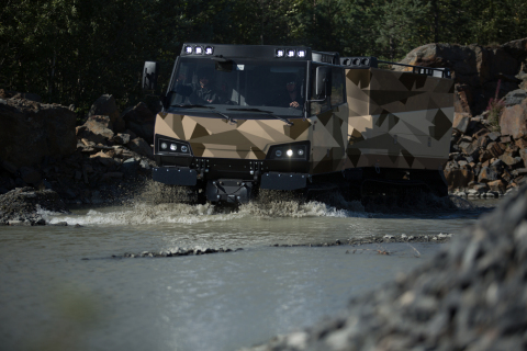 BAE Systems' Beowulf all-terrain vehicle can traverse through water, swamps, snow and soft sand; and ...