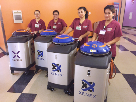CHLA Environmental Services staff combine the UV light of the Xenex robots with more traditional cleaning techniques to disinfect patient rooms. (Photo by Children's Hospital Los Angeles)