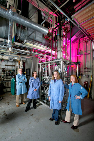 Members of the CO2 capture team in Niskayuna in front of a bench-scale CO2 capture system they have  ...
