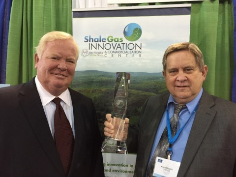 Bill Hall, SGICC Director pictured with Mark Miller, President of FyreRok Reservoir Consulting, LLC, the 2015 SGICC EH&S Award Winner (Photo: Business Wire)