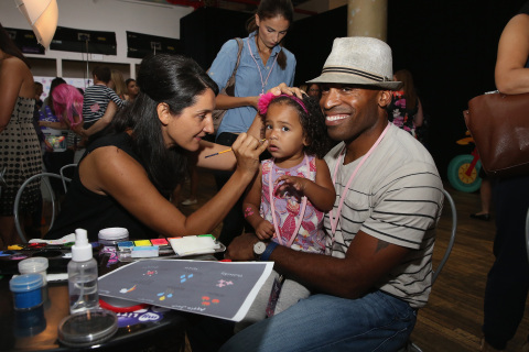 "Tiki Barber holds his daughter Brooklyn while she gets her face painted during the 'purple carpet' premiere screening of the ""My Little Pony Equestria Girls Friendship Games"" animated film, held at the Angelika Film Center in New York City on September 17, 2015. Hasbro celebrated the world premiere of ""My Little Pony Equestria Girls Friendship Games,"" a Hasbro Studios full-length animated feature film and the third installment in the beloved MY LITTLE PONY EQUESTRIA GIRLS franchise. (Getty Images for Hasbro)"