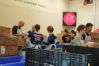 DHL Supply Chain employees sorting and packing food at the Mid-Ohio Foodbank. Associates also volunteered by raising funds, which together with the company's matching donation, resulted in 97,983 meals going to those in need throughout Central Ohio. (Photo: Business Wire)