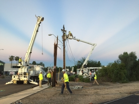 APS crews replace a wooden pole splintered by an intense storm last week. Within the last three weeks, five powerful storms have hammered the Phoenix metro area. Those storms, with winds upwards of 90 mph, have caused significant damage, leaving hundreds of thousands of customers without electricity and knocking down 485 power poles - an 81 percent increase from 2014 (Photo: Business Wire)