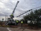 APS crews replace a steel pole bent in half by an intense storm last week. Within the last three weeks, five powerful storms have hammered the Phoenix metro area. Those storms, with winds upwards of 90 mph, have caused significant damage, leaving hundreds of thousands of customers without electricity and knocking down 485 power poles - an 81 percent increase from 2014 (Photo: Business Wire)
