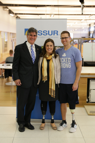 US Ambassador Robert C. Barber accompanies Boston Marathon Bombing Survivors Patrick Downes and Jessica Kensky during their visit to prosthetics maker Ossur in Reykjavik, Iceland.