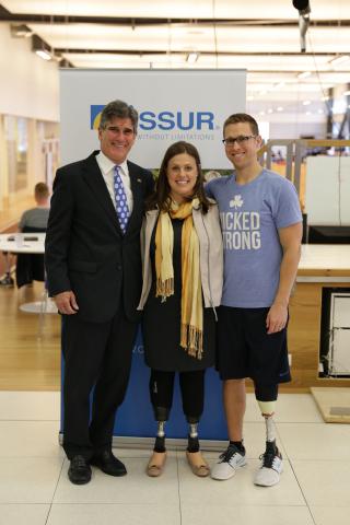 US Ambassador Robert C. Barber accompanies Boston Marathon Bombing Survivors Patrick Downes and Jessica Kensky during their visit to prosthetics maker Ossur in Reykjavik, Iceland.