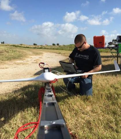 MTSI aerospace engineer, Matt Deal, prepares the Bramor for launch (Photo: Business Wire)