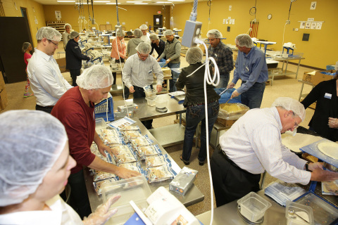 UnitedHealth Group, UnitedHealthcare and Optum employees volunteer at Feed My Starving Children in Minneapolis as part of a day of service (Photo: UnitedHealth Group).