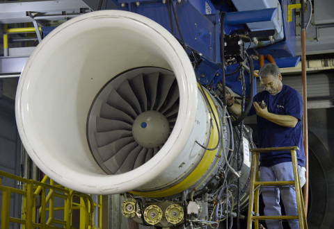 Rolls-Royce team member Richard Wilson prepares Rolls-Royce's AE 3007 jet engine for testing at the  ...