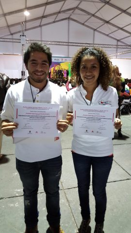 Students Tupak Hernandez and Berenice Perez receive the Axalta Special Science Award during the Mexi ...