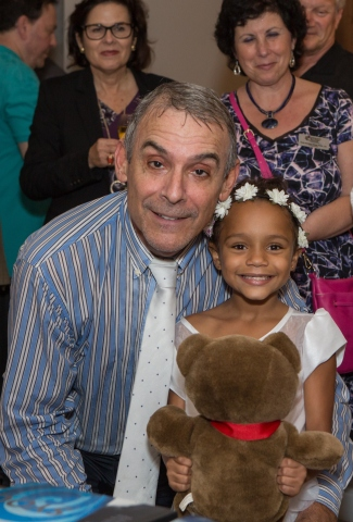 Thomas P. Severino, president/CEO of the Broward Education Foundation and eight-year-old Samara who is one of the students in the documentary and benefiting from the campaign. (Photo: Business Wire)