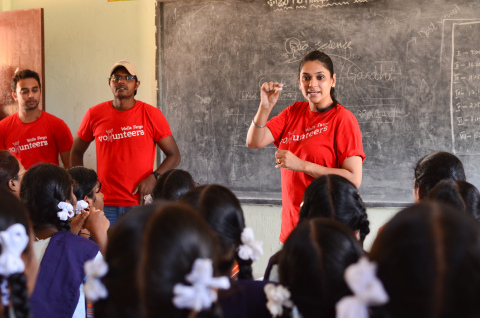 A Wells Fargo volunteer teaching students at the Kothaguda School in Hyderabad as part of the volunt ...